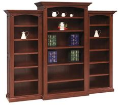 Amish Deluxe Bookcase with Raised Panel Sides 3 Piece Set A total of 15 shelves line this solid wood bookcase from DutchCrafters. Details include raised panel sides, a shiplap back, dentil molding, rosettes and fluting. Bookcase Wall Unit, Bookcase With Glass Doors, Built In Bookcase, Bookcases, Amish Furniture, Furniture Sale, Custom Furniture, Furniture Making, Office Furniture