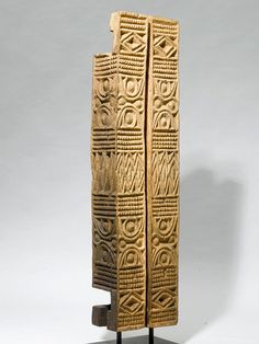 Architecture frameworks wooden door decorated with geometric reliefs representing part of very highly stylized figurative motifs, Cameroon.