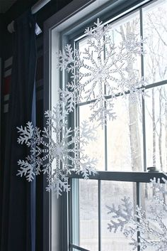 Holiday Home Series: Nautical Christmas Dollar Store snowflakes in a window