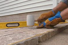 Learn how to lay paving stones with the instructions and tips in this useful diy paths and patios guide.