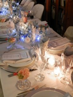 With the fairy lights in the flower arrangements and all the candles on the table lit.
