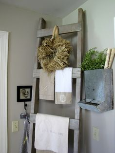 Farmhouse ladder in the kitchen and great vintage pig feeder.
