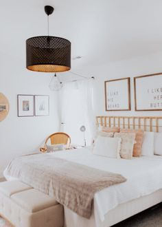 modern bohemian style home decor and master bedroom with rattan and bamboo and fun light fixtures blush pink, tan and white