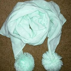 Authentic Juicy Couture Teal Scarf Beautiful teal scarf with furry pom pom balls at the end. This is awesome with any outfit. Great accessory for fall. Juicy Couture Accessories Scarves & Wraps