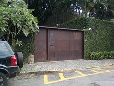 portão em aço corten casa leblon - gisele taranto