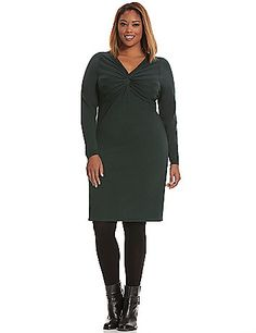 A soft and sassy classic with a trend-right twist, our cozy sweater dress is reimagined with a flattering twisted V-neck. Ideal for day or evening with long sleeves and the perfect knee length to wear on its own or layered over your favorite tights. lanebryant.com