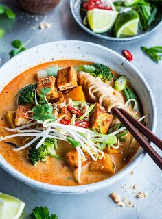 A fragrant red curry and coconut laksa with crispy tofu, pumpkin and greens.