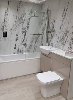 Marble Bathroom Get the look using tiles or shower boards - marble, the timeless classic in any bath Small Half Bathrooms, Contemporary Bathrooms, Bathroom Modern, Bathroom Sink Cabinets, Bathroom Interior Design, Timeless Classic, Get The Look, Bathroom Accessories, Free Design