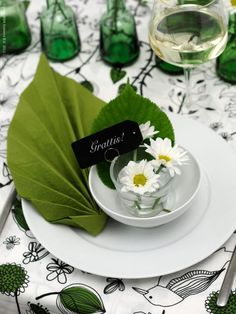 Nature inspired place setting with leaf napkin.