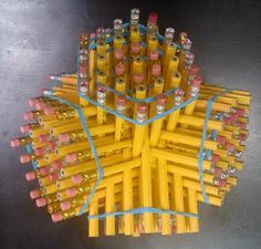 """A sheaf of pencils  Mathematician Andrew Ranicki took this picture of a """"sheaf of pencils"""" at the American Institute of Mathematics in Palo Alto, California.   The name """"sheaf of pencils"""" is funny to researchers in algebraic geometry, where the words sheaf and pencil have technical mathematical definitions.  I found this picture via David John Benson on Facebook.  Relevant links American Institute of Mathematics: http://aimath.org/"""