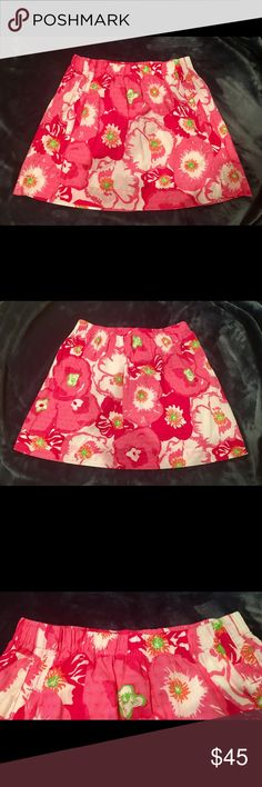 "Lilly Pulitzer Small Pink White Floral Skirt Adorable Lilly Pulitzer A-line Floral Skirt. Size - Small. This adorable skirt is pink with white, orange and green splashed in. It has side pockets, dot texture and is fully lined. 100% Cotton.   Excellent pre-owned condition, no known flaws. No stains or tears. There is the number ""18"" written on the Lilly tag. Lilly Pulitzer Skirts A-Line or Full"