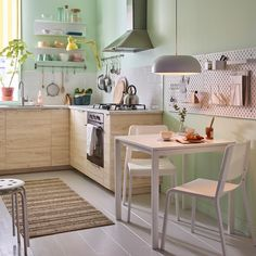 A small, beige, green and white kitchen with white MELLTORP table and two stackable TEODORES chairs. Small Space Living, Home Decor Furniture, Beautiful Kitchens, Small Apartments, Interior Inspiration, Home Kitchens, Kitchen Dining, Sweet Home, New Homes