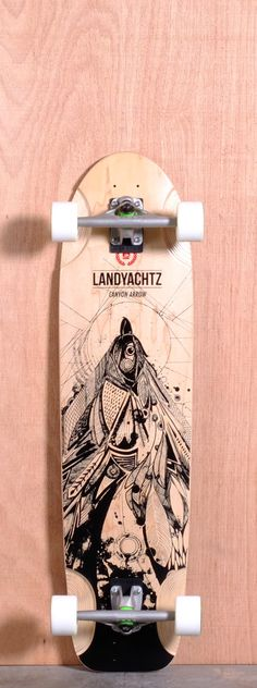 """The Landyachtz Canyon Arrow Longboard Deck is designed for Downhill and Freeride. Ships fully assembled and ready to skate! Function: Downhill, Freeride Features: Medium W Concave, Multiple Wheelbase Options, Wheel Wells Material: 9 Ply Maple Length: 37"""" Width: 9.5"""" Wheelbase: 24.75"""" - 28.5"""" Thickness: 5/8"""" Hole Pattern: New School Grip: Black"""