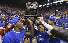 Kansas forward Cheick Diallo, Devonte' Graham and the rest of the Jayhawks hoist the league trophy as they celebrate locking up a share of their twelfth-straight Big 12 title with the trophy following their 67-58 win over the Red Raiders, Saturday, Feb. 27, 2016 at Allen Fieldhouse.