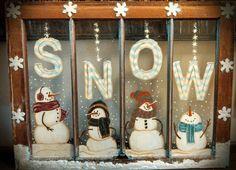 Snowmen painted on old window.