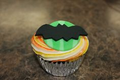"Halloween Cupcake ~ Bats Fondant bat, striped ""moon"" and variegated butter-cream frosting"