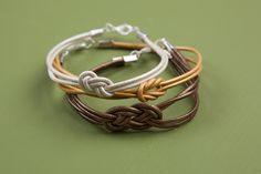 These simple knot bracelets are my new favorite stacking pieces. They're simple enough that they look good with almost any style of bangle, and they're light and comfortable to wear. Now that I've got the hang of making these, I'm thinking these would be perfect little birthday gifts for friends, or even holiday stocking stuffers. Just mount them onto a pretty piece of cardstock with a little hand-written note!