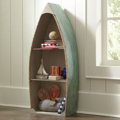 Prepster: Ready to Row Bookshelf | Styled after a rustic row boat, this small bookshelf elicits memories of camp, the lakehouse, or just lazy summer days. With three shelves that can easily hold books and display photos or figurines, this shelf offers storage with a sculptural twist.