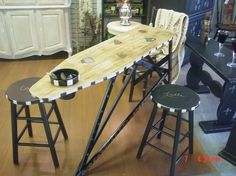 Cafe table made from an old wooden ironing board.: