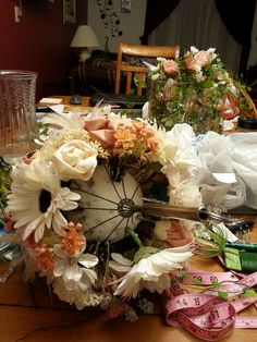 my daughter made her own bouquet, using a kitchen whisk with a Styrofoam ball, and a mixture of silk, handmade, or altered fabric flowers