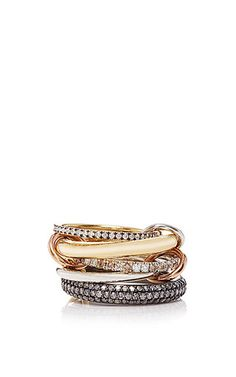 This **Spinelli Kilcollin** ring features versatile, exquisite interlocking bands that delicately drape across multiple fingers or delicately layer on one, which epitomizes the brand's industrial, yet feminine aesthetic