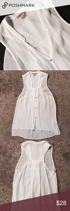 Helmet Lang Sheer Hi Low Top Helmet Lang for Intermix Sheer Hi Low Top in white gauzy stretch cotton blend. Three button vneck with front darting. Side bottom slits. Racer back with flowey pleats at mid back. Loose casual basic! Helmut Lang Tops Blouses