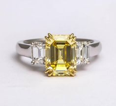 Rare Fancy Vivid Yellow Emerald Cut Ring | From a unique collection of vintage three-stone rings at https://www.1stdibs.com/jewelry/rings/three-stone-rings/