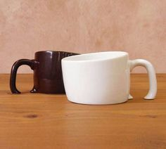 Mugs that look like they're sinking in the table.