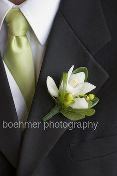 cymbidium orchid wedding flower boutonniere, groom boutonniere, groom flowers, add pic source on comment and we will update it. www.myfloweraffair.com can create this beautiful wedding flower look.