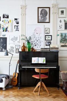 Swedish living space with a piano and a gallery wall