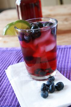 Blueberry Spritzer:   3 cups blueberry-pomegranate juice,   11/2 cups sparkling water,   1 cup fresh blueberries,   1 Ice cubes,   1 Lime slices,