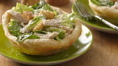 CAESAR SALAD BOWL FOR 2: Add some chicken to Caesar salad, and serve it in a bread bowl.