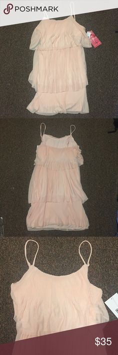NWT Blush Tiered Dress Juniors blush ruffled dress by Emerald Sundae with adjustable straps. 100% polyester. Same dress as the black dress listed Emerald Sundae Dresses