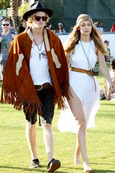 The 18 Most Stylish Couples At Coachella  #refinery29  http://www.refinery29.com/2015/04/85941/cutest-couples-coachella-2015-pictures#slide-8  Fringe? Check. Hippie headband and thigh-high slit? Check and check. Gigi Hadid and Cody Simpson were the picture of boho chic at the festival's first weekend.