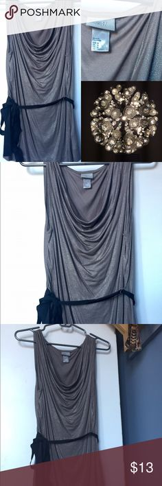 Silver top with shimmer and black belt from H&M This never been worn silver top would work great under under a jacket or sweater for a daytime look, and can also work for an evening look. It was a gift, and has never been worn H&M Tops Tank Tops