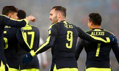 Lucas Perez celebrates scoring his hat-trick