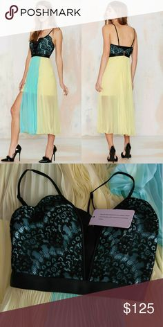 Three Floor Creme On Glaze Dress The Creme on Glaze Dress features a pastel yellow accordion pleated skirt with turquoise panel at center, black lace and turquoise top, & padded cups. NWT! Three Floor Dresses Midi