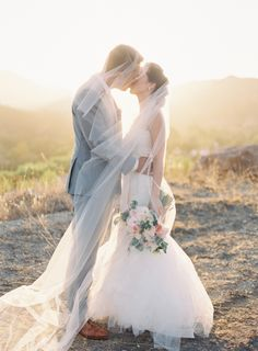 A veiled kiss: http://www.stylemepretty.com/2015/07/16/15-gorgeous-golden-hour-photos/