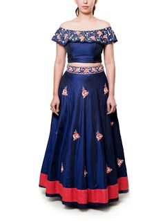 This gorgeous navy blue lehenga by Neha Gursahani stylishly blends modern contemporary appeal and traditional colourful embroidery. The navy blue off shouldered choli features an embroidered attached cape adorned with thread and bead work embroidery