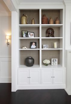 I love the fabric wall treatment behind the shelves. Nice accent for a beautiful display area. PLD Custom Home Builders
