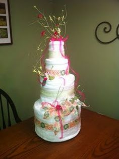 Towel cake for a bridal shower.  We used this cake as a money tree by attaching money to paper flowers that coordinated with the cake and were slipped in between the layers of the towels.  #bridalshower