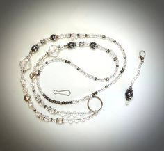 Check out this item in my Etsy shop https://www.etsy.com/listing/547984499/silver-clear-gray-noveau-lanyardstunning