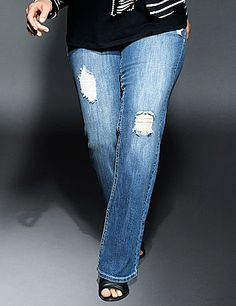 Your edgy, city-chic style is ready for anything in our destructed bootcut jean. Detailed with rips and abrasions to keep the look on-trend, this is THE must-have denim for this seasons fashionista because its easy-wearing, totally casual and even more comfortable! Classic five-pocket design, button  zip fly closure and belt loops complete the look. Available in Petite and Tall sizes. lanebryant.com