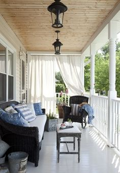 Me and porches= true love. I kinda feel like I NEED one. White curtains blowing in the wind..rocker..wood ceiling..add guitar, soul mate, my dog and I'd be all set. Gezzz this sure is the life! love the painted floors !