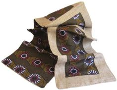 """African Print & Jute Burlap Table Runner (Daisy) by Taraluna Fair Trade, Organic & Green Gifts. $40.00. Two-in-one reversible table runners.. Made in Malawi featuring African wax-print textiles with natural jute trim.. One side features a geometric patchwork of African textile squares with a jute burlap border. The other side is a solid piece of African print.. Machine wash, air dry, 13"""" x 72"""". Check out our matching napkins!. Fair Trade allows artisans a fair..."""