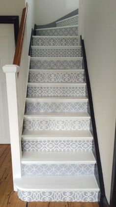 Stenciled stair case. Well worth the effort, with stencils from the Royal Design Studio