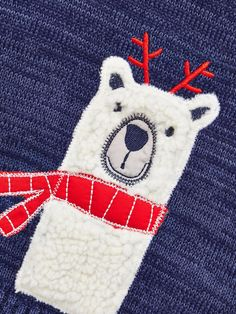 Ladybird Baby Boys Festive Polar Bear Jumper Wrap your baby boy in a cosy and cuddly knit for Christmas with this adorable polar bear jumper by Ladybird. Offering a warm bear hug in a snuggly knitted fabric, the chunky blue jumper features a cute 3D bear to the centre in touchable fleece who's wearing a red winter scarf and a pair of festive reindeer antlers. The long sleeves contrast in classic Breton-style stripes, while tortoiseshell buttons fasten to the shoulder for quick dressing an...