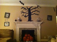My mantlescape is ready for Halloween!  I made the creepy tree silhouette this afternoon.