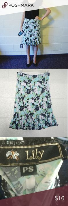 """Lily Floral Skirt Beautiful and flowy skirt with a pencil style and flowy at the end. Black, white, turquoise and mint floral pattern. Bold and classy. Excellent condition! Size small P but would fit a regular length small just fine (I'm 5'6"""" and hit is knee length). Willing to accept offers. Bundle to save. Lily Skirts Midi"""
