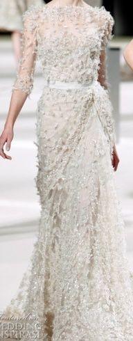 Ellie Saab . Wedding #style    For tips   ideas on #fashion,visit www.makeupbymissc...